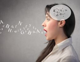 Woman talking with alphabet letters in her head and coming out of her mouth